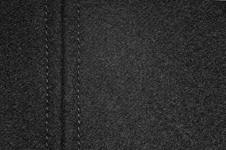margine: sfondo di tela nera con un margine o in granelli texture di tessuto Archivio Fotografico