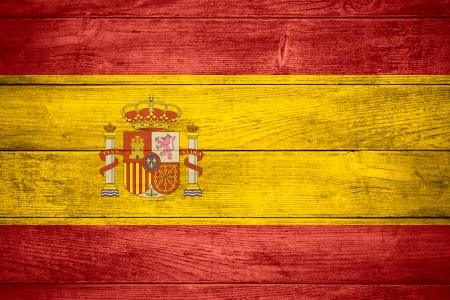 flag of Spain or Spanish banner on wooden background Stockfoto
