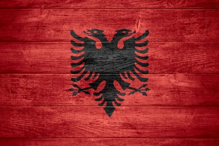 albanian: flag of Albania or Albanian banner on wooden background Stock Photo