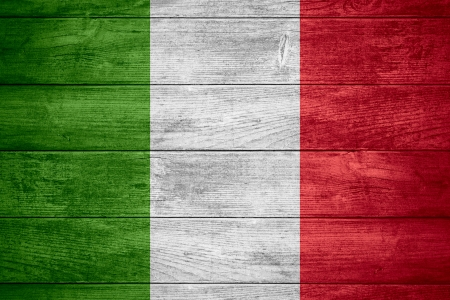 flag of Italy or Italian banner on wooden background