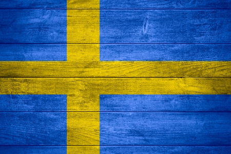 flag of Sweden or Swedish banner on wooden background Stock Photo