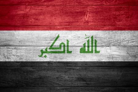 iraqi: flag of Iraq or  Iraqi banner on wooden background