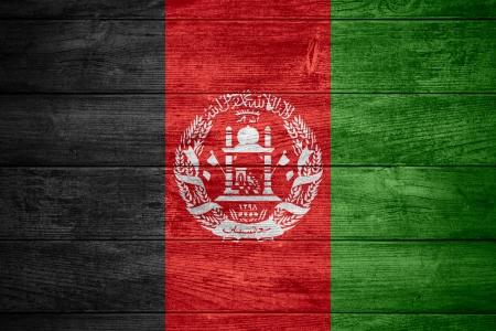afghan flag: flag of  Afghanistan or Afghan banner on wooden background