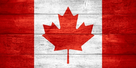 flag of Canada or  Canadian banner on wooden background