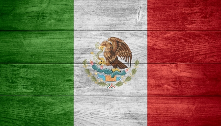flag of Mexico or Mexican banner on wooden background
