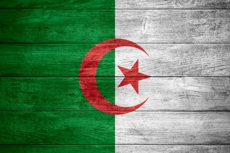 Algierski: flag of Algeria or Algerian banner on wooden background Zdjęcie Seryjne