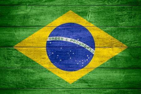 flag of  Brazil or  Brazilian banner on wooden background