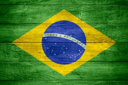 flag of  Brazil or  Brazilian banner on wooden background