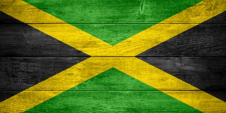 flag of Jamaica or  Jamaican banner on wooden background photo