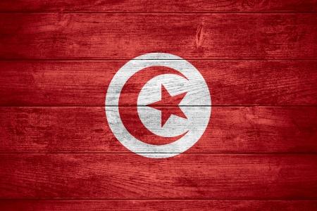 tunisian: flag of Tunisia or Tunisian banner on wooden background
