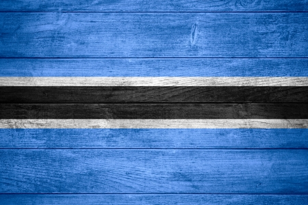 botswanan: flag of Botswana or Botswanan banner on wooden background