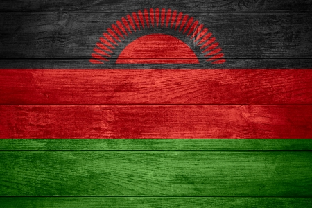 malawian flag: flag of Malawi or Malawian banner on wooden background