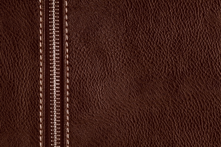 brown leather background with silver metal zipper or sepia natural texture photo