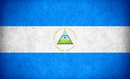 nicaraguan: flag of Nicaragua or Nicaraguan banner on paper rough pattern texture Stock Photo