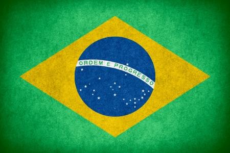 brazilian flag: flag of Brazil or Brazilian banner on paper rough pattern texture Stock Photo