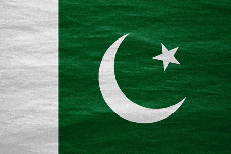pakistani pakistan: flag of Pakistan or Pakistani banner on canvas texture Stock Photo