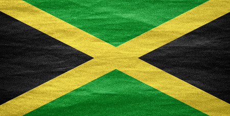 jamaican: flag of Jamaica or Jamaican banner on canvas texture