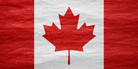 nationalities: flag of Canada or Canadian banner on canvas texture Stock Photo