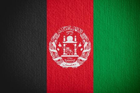 afghan flag: flag of Afghanistan or Afghan banner on paper background