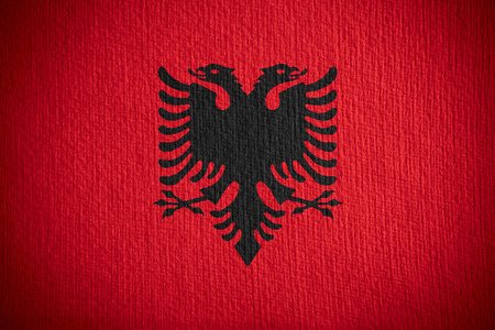 albanian: flag of Albania or Albanian banner on paper background
