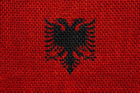 albanian: flag of Albania or Albanian banner on linen background