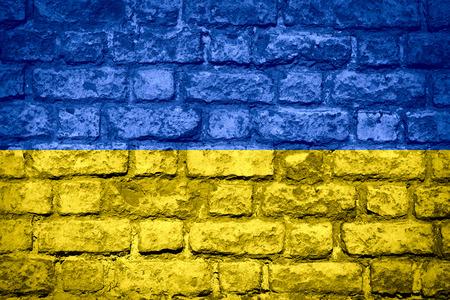 flag of Ukraine or Ukrainian banner on brick texture Фото со стока