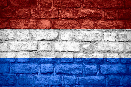 holand: flag of Holand or Dutch banner on brick texture, Netherlands Stock Photo