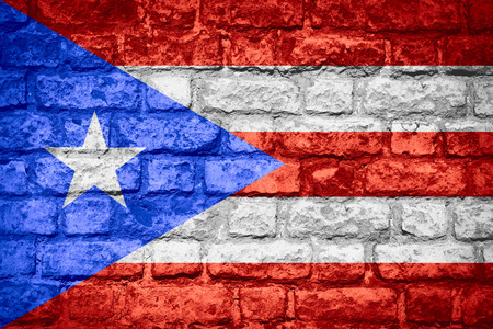 puerto rican: flag of Puerto Rico or Puerto Rican banner on brick texture