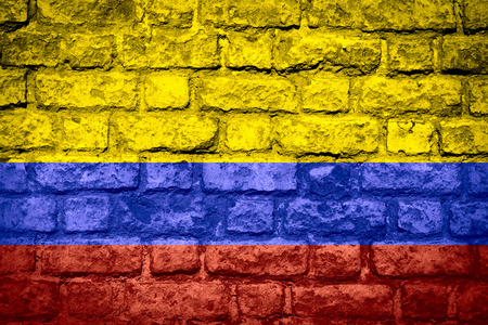 colombian: flag of Colombia or Colombian banner on brick texture