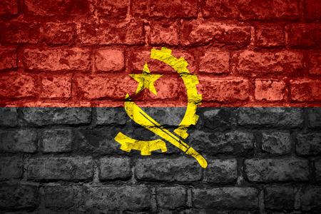 angola: flag of  Angola or Angolan banner on brick texture