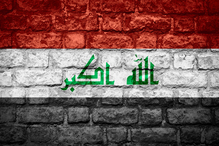 iraqi: flag of Iraq or Iraqi banner on brick texture Stock Photo