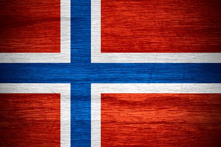 Norway flag or Norwegian banner on wooden texture