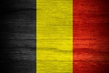 belgium flag: Belgium flag or Belgian banner on wooden texture Stock Photo