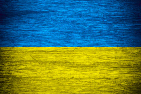 Ukraine flag or banner on wooden texture Фото со стока