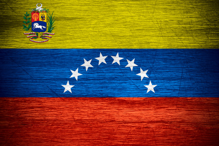 venezuela flag: Venezuela flag or Venezuelan banner on wooden texture