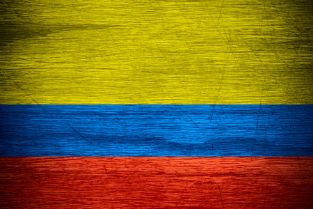 colombia flag: Colombia flag or Colombian banner on wooden texture