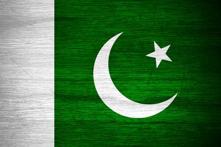 pakistan flag: Pakistan flag or Pakistani banner on wooden texture