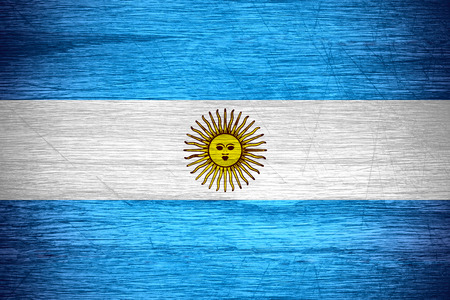 argentinian: Argentina flag or Argentinian banner on wooden texture