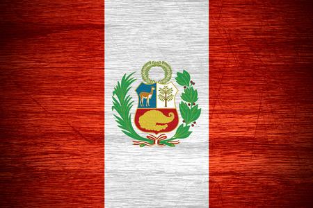 Peru flag or Peruvian banner on wooden texture