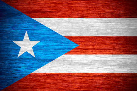 puerto rico: Puerto Rico flag or banner on wooden texture