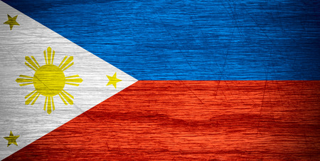 philippine: Philippines flag or Philippine banner on wooden texture
