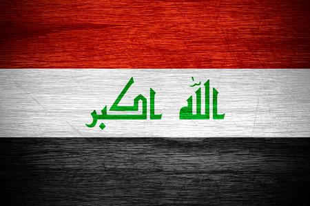 iraq: Iraq flag or Iraqi banner on wooden texture