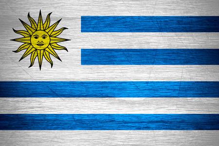uruguay flag: Uruguay flag or Uruguayan banner on wooden texture Stock Photo