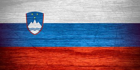 slovenian: Slovenia flag or Slovenian banner on wooden texture Stock Photo