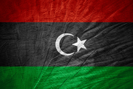 libyan: Libya flag or Libyan banner on wooden texture