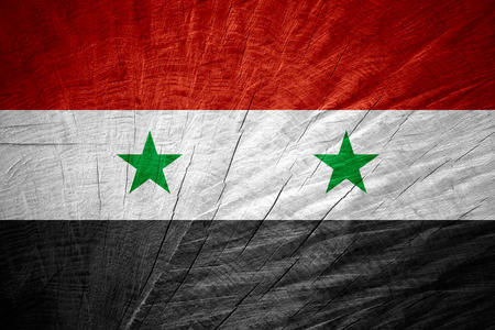 syrian: Syria flag or Syrian banner on wooden texture Stock Photo