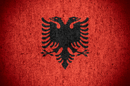 albanian: flag of Albania or Albanian banner on rough pattern texture Stock Photo