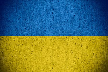 flag of Ukraine or Ukrainian banner on rough pattern texture