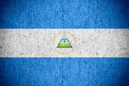 nicaraguan: flag of Nicaragua or Nicaraguan banner on rough pattern texture Stock Photo