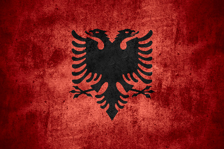 albanian: flag of Albania or Albanian banner on rough pattern texture background